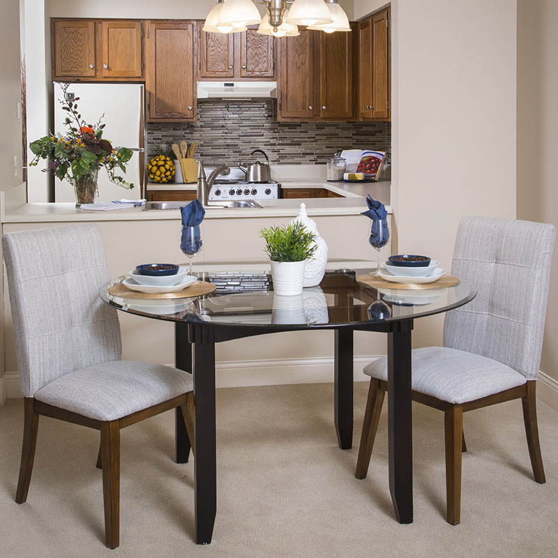 A fully furnished dining room in a 10 Wilmington Place apartment
