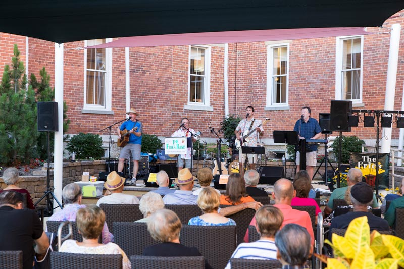 10 Wilmington Place residents enjoy live music at the amphitheater