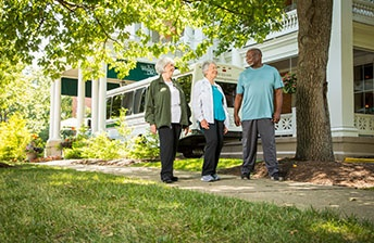 Resident friends explore the multiple walking paths at 10 Wilmington Place