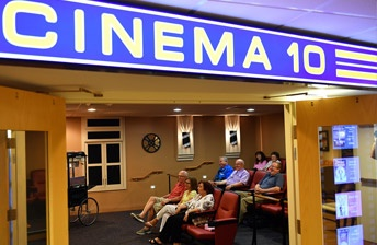 Residents watching a movie in cinema 10 at 10 Wilmington Place