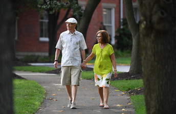 Resident Couple explore the multiple walking paths at 10 Wilmington Place