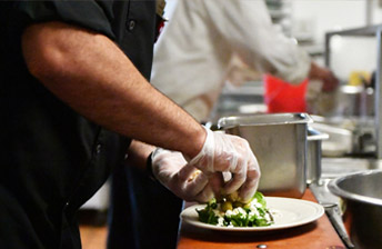 10 Wilmington Place chef working on a beutfully green salad.