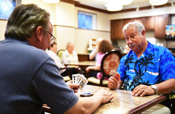 Residents play cards at 10 Wilmington Place